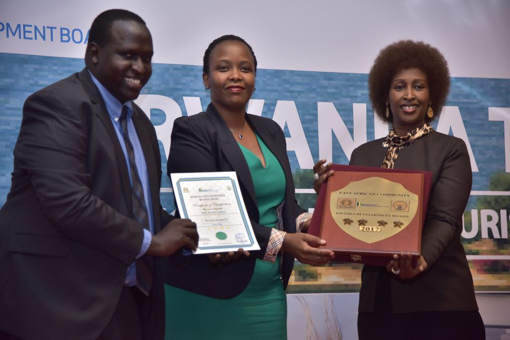 Honorable Clare Akamanzi CEO of RDB handing over the operating licence and grade plaque to Hotel des Milles Collines (Picture by Gentil Gisubizo)