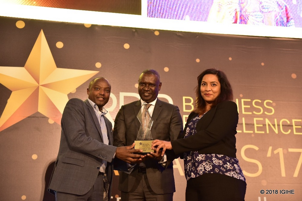 PSF Chairman Benjamin Gasamagera hands the Investor of the Year Award to Africa Improved Foods