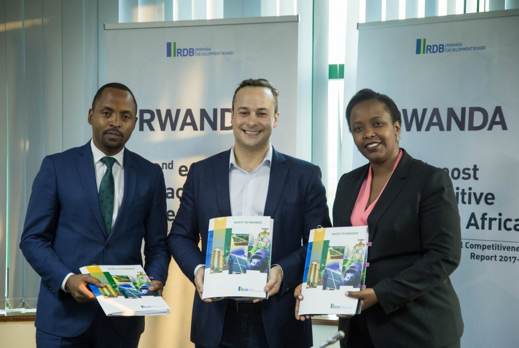 Minister of ICT Jean de Dieu Rurangira (L) Andela CEO Jeremy Johnson (C) and RDB CEO Clare Akamanzi