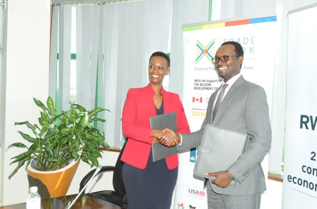 RDB Deputy Chief Executive Officer and Chief Operating Officer Emmanuel Hategeka and TMEA Country Director Patience Mutesi Gatera shaking hands after the signing partnership agreement
