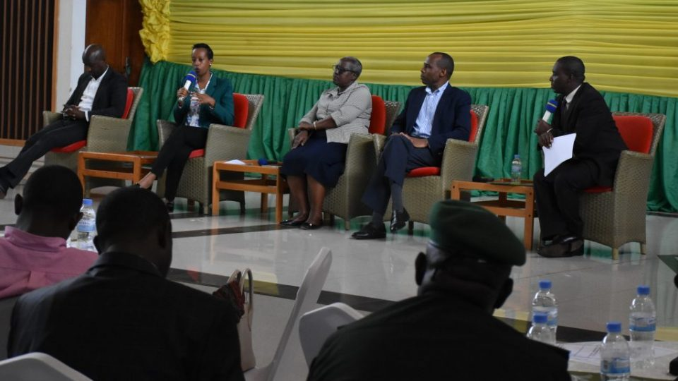 Denise Umunyana, co-founder of Right Seat Ltd. (on mic) participates in a panel discussion on the investment opportunities in the Southern province during the forum on 8th December 2018
