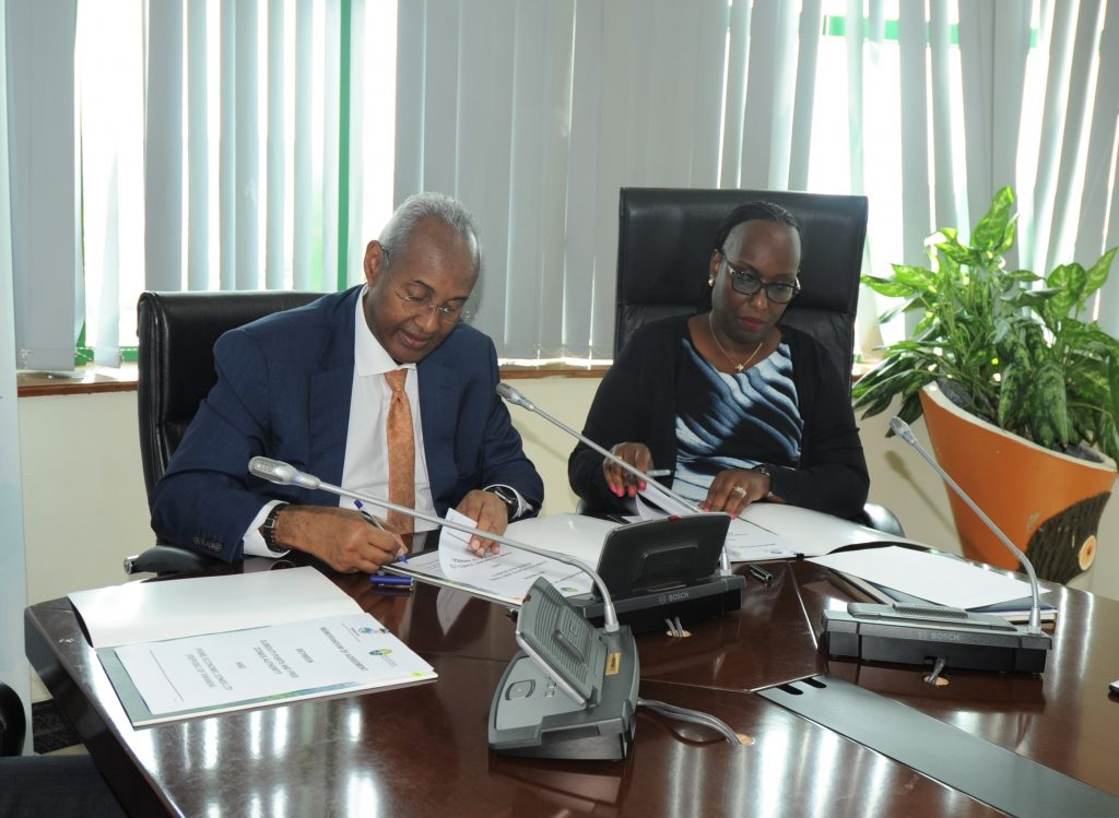 Chairman of the DPFZA Omar Hadi Aboubaker (L) and the Managing Director of PEZ Jeanne Isabelle Gasana (R) sign the MoU for the development of the 10-hectare land t