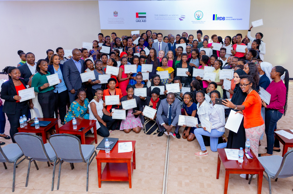Women who received tourism and hospitality training from UAE experts posing with officials