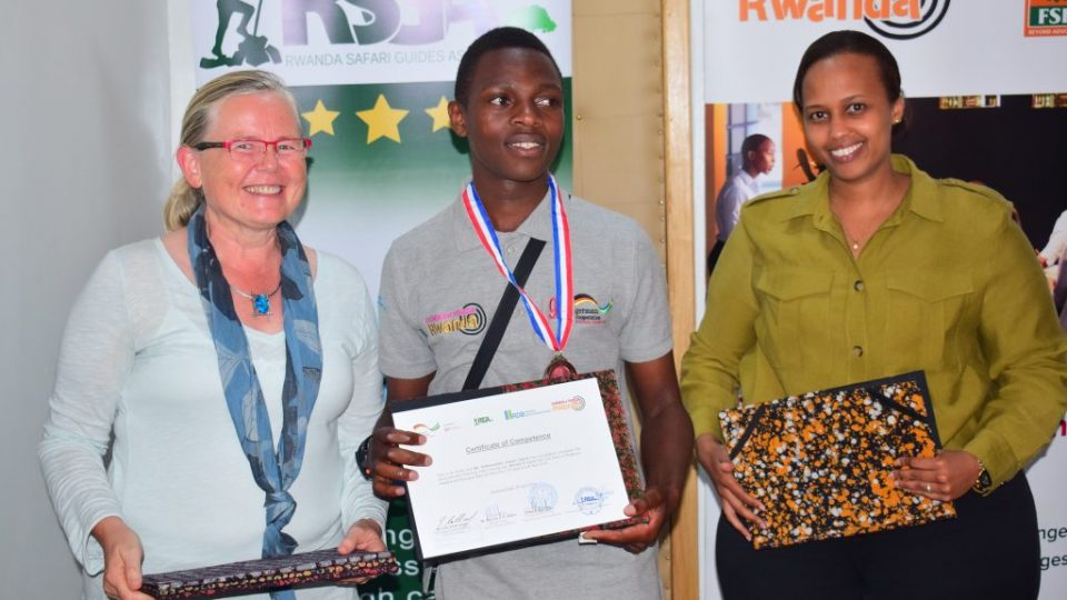 Ellen Kallinowsky, the Principal Technical Advisor of the Eco-Emploi Program at GIZ (L), one of the newly certified birding guides (C) and the RDB Head of Tourism and Conservation, Ariella Kageruka (R)