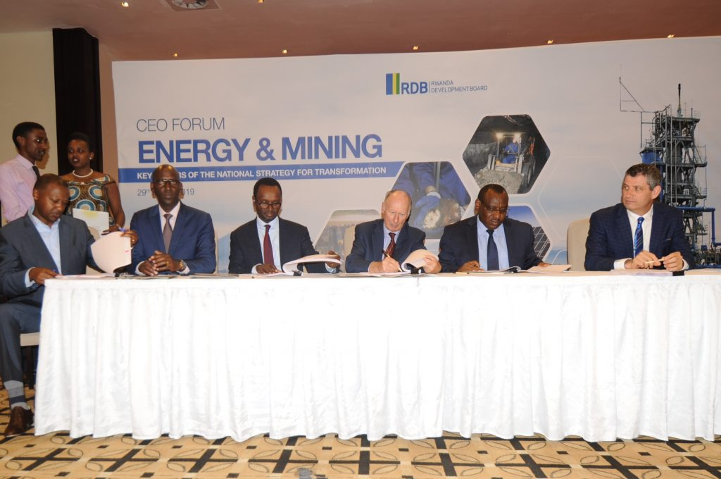 From R-L, the REG CEO, Ron Weiss, Minister of Infrastructure, Amb. Gatete, Symbion Power CEO, Lord Irvine Laidlaw and RDB Deputy CEO, Emmanuel Hategeka sign the US$200 million Concession and Power Purchase Agree
