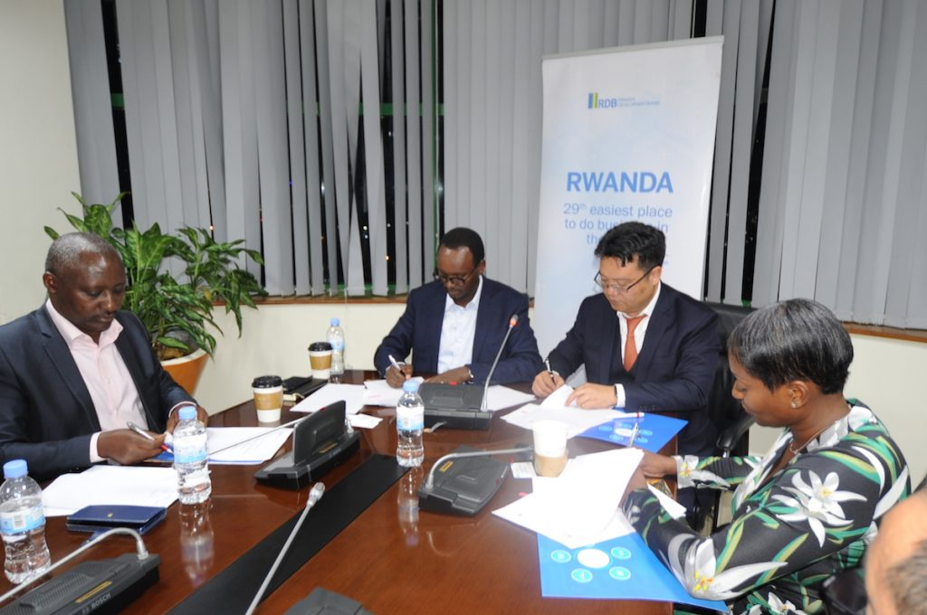 From L-R, KESI Rwanda Executive Chairman, Robert Bapfakulera, RDB's Deputy CEO, Emmanuel Hategeka and Pink Mango C&D's Director, Gordon Gu sign the agreements