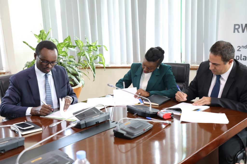 From L-R, RDB's Deputy CEO, Emmanuel Hategeka, Minister of ICT & Innovation, Paula Ingabire and Motorola Solutions General Manager, Yuval Hanan sign the agreement