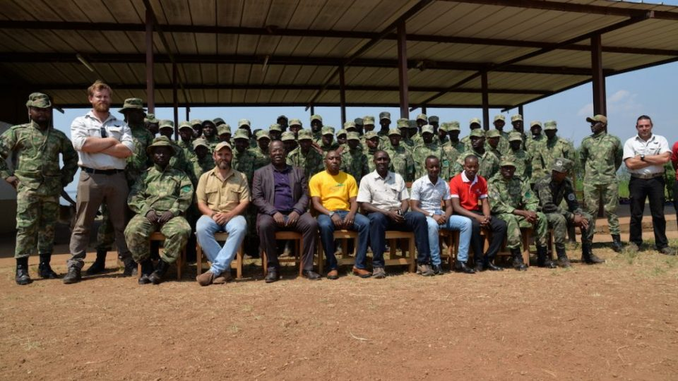 RDB's Ngoga, Akagera Park Manager and Jes Gruner (center from left) pose for a group photo with the new rangers after the ceremony today