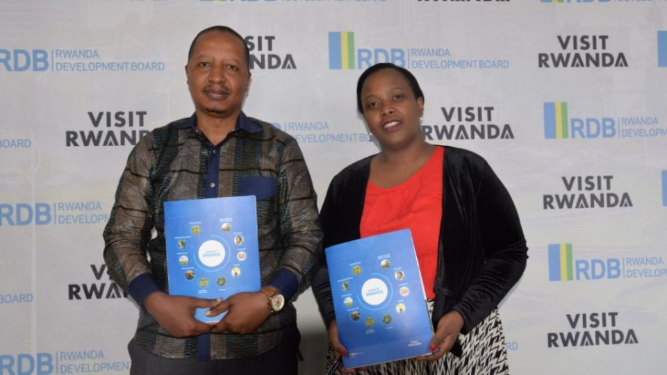 RDB's CEO Clare Akamanzi (L) and Roger Nkubito, Managing Director of Bollore Logistics, the parent company of Vivendi Group in Rwanda after signing the agreement yesterday