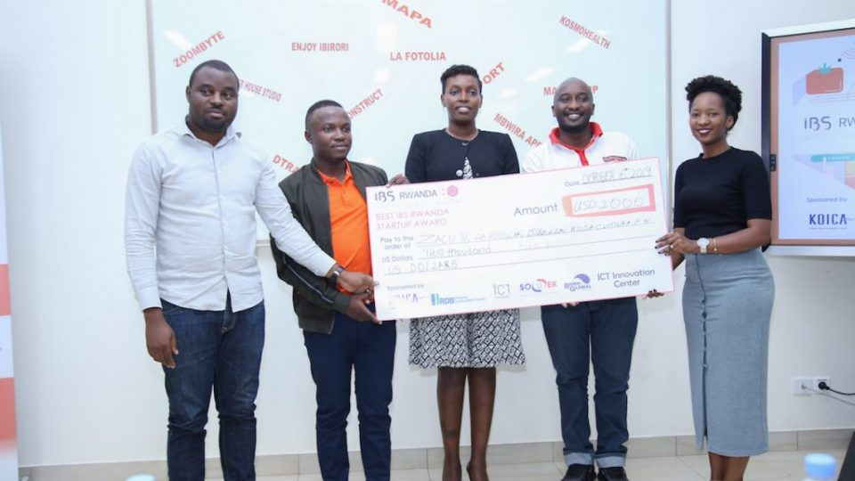 Permanent Secretary in Ministry of ICT & Innovation, Claudette Irere handing over the dummy check to winners of Inclusive Business Solution Program