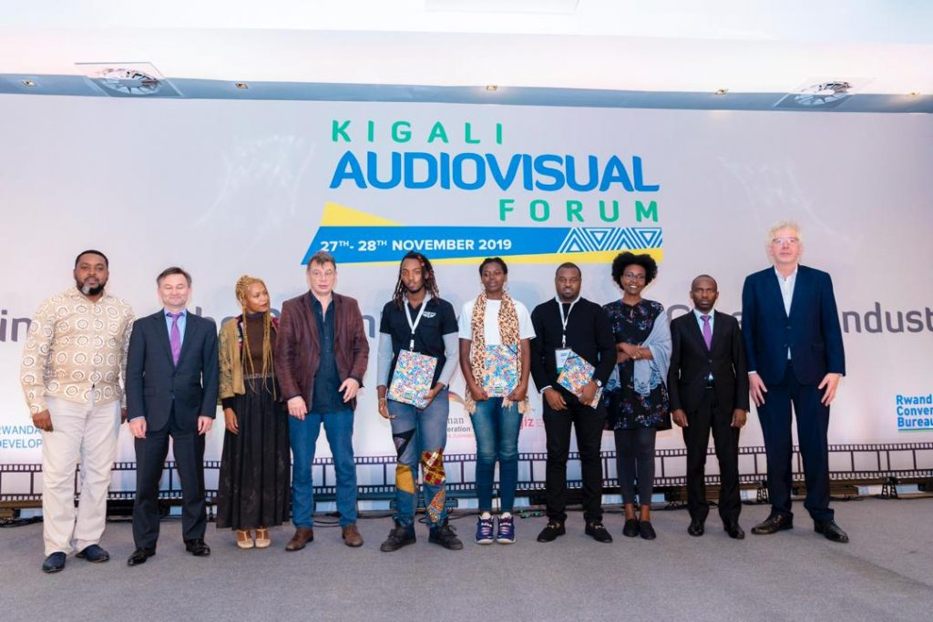 This year's Kigali Audio Visual Forum Organisers pose for a group photo with film makers whose pitches won them prizes