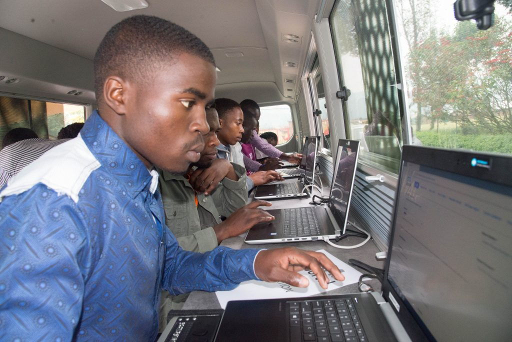 Some of the 200 youth register on RDB's online job portal, kora.rw in the mobile employment service bus in Musanze today